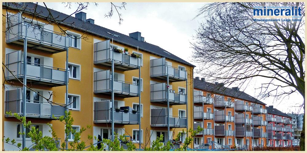 Neubaublock: Sanierung mit vorgestellten Balkonanlagen